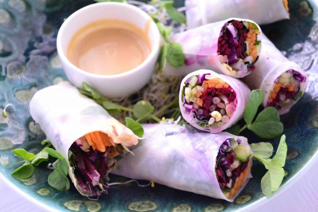raw rainbow spring rolls with peanut and ginger sauce